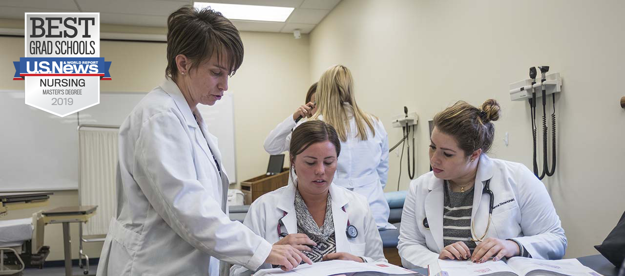 Detroit Mercy Nursing students look over material.